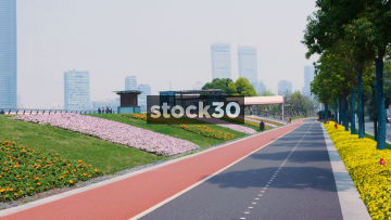 Bike And Footpath Running Along Binjiang Road By The Huangpu River In Shanghai, China