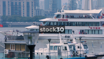 A Cruise Ship Passing On The Huangpu River In Shanghai, China