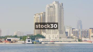A Boat Passing On The Dubai Creek By Obeid Juma Bin Suloom Shipyard In Dubai, UAE