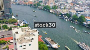 Several Boats Passing On The Chao Phraya River In Bangkok, Thailand