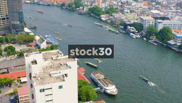 Timelapse Shot Of Boats Passing On The Chao Phraya River In Bangkok, Thailand