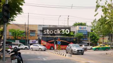 Traffic Passing On Somdet Chao Phaya Road In Bangkok, Thailand