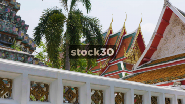 The Wat Arun Ratchawaram Ratchaworamawihan Temple And Nearby Buildings In Bangkok, Thailand