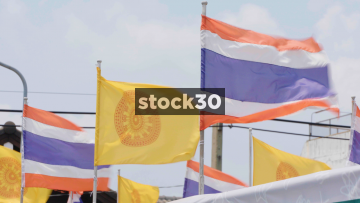 The Thai Flag And The Dharmacakra Flag Of Buddhism In Bangkok, Thailand