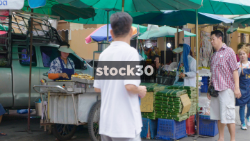 A Thai Lady Preparing And Selling Street Food In Bangkok, Thailand