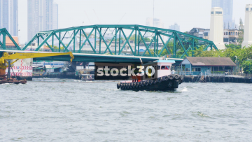 Tug Boats And Tour Boats On The Chao Phraya River In Bangkok, Thailand