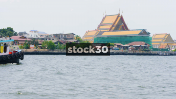 Several Boats On The Chao Phraya River In Bangkok, Thailand