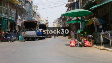 A Small Side Street With Local Markets In Bangkok, Thailand