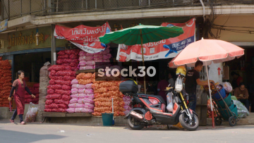 A Market Stall Selling Onions And Garlic in Bangkok, Thailand
