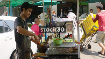 A Man Preparing Thai Street Food In Bangkok, Thailand
