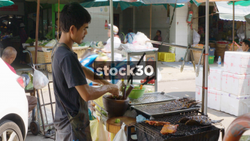 A Street Food Vendor Preparing Food In Bangkok, Thailand