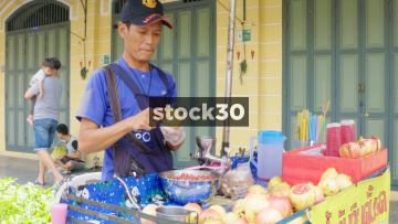 A Man Preparing Pomegranate Juice In Bangkok, Thailand