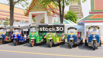 A Line Of Tuk Tuk Taxis By Wat Phra Chetuphon Vimolmangklararm Rajwaramahaviharn In Bangkok, Thailand