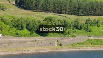 Traffic Passing By The Woodhead Reservoir In Longendale, North Derbyshire, UK