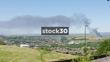 Wide Shot Of Smoke From  Large Fire Burning In The Peak District, UK