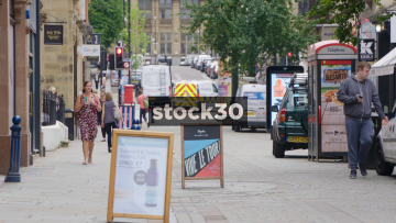 King Street In Manchester With Pedestrians And Passing Tram, UK
