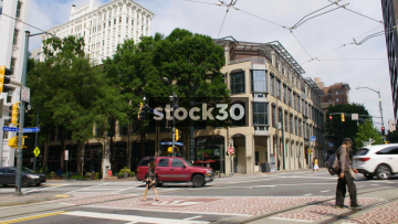 Traffic Passing At The Corner Of Auburn Avenue And Peachtree Street In Atlanta, USA