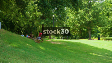 A Young Couple In The Meadow At Piedmont Park In Atlanta, USA