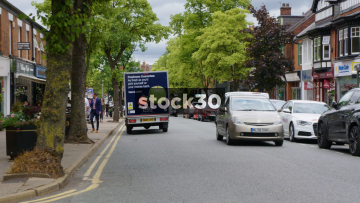 London Road In Alderley Edge, Cheshire With Passing Traffic And Pedestrians, UK