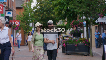 Pededstrians And Shoppers In Wilmslow, UK