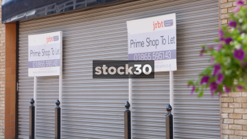 Empty Shop Unit With To Let Signs Outside, UK