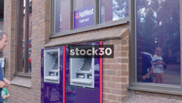 Man Withdrawing Cash From Natwest Cash Machine, UK
