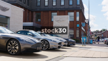 Cars Parked Outside Aston Martin Garage In Wilmslow, UK