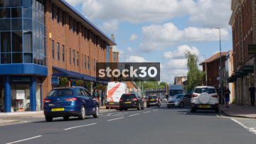Altrincham Road In Wilmslow With Passing Traffic, UK