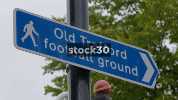 Old Trafford Directions Signs In Manchester, UK