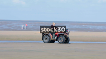 Men Riding Quad Bikes Over Crosby Beach Near Liverpool, UK