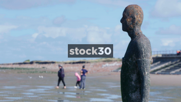 Cast Iron Figure From Anthony Gormley's Another Place Sculpture On Crosby Beach, UK