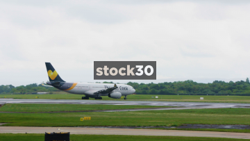 Thomas Cook Airbus A330-243 And AirTransat Airbus A330-243 Taxiing At Manchester Airport, UK