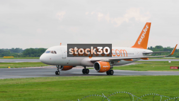EasyJet Airbus A320-214 Taxiing At Manchester Airport, UK