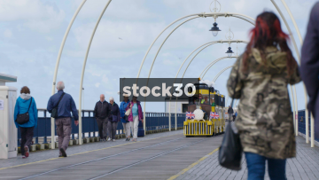 Close Up Shot Of The Promenade Express Train Passing By On Southport Pier, UK