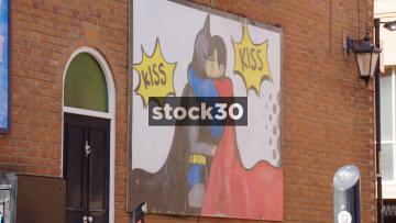 Batman And Robin Kiss Artwork On The Side Of The New Union Hotel On Canal Street In Manchester, UK