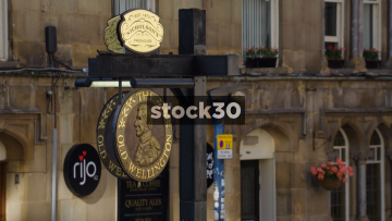 The Old Wellington Pub In Manchester. Close Up On Sign And Wide Shot