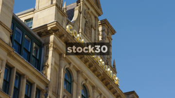 The Corn Exchange In Manchester. Close Up On Sign Followed By Wide Shot.