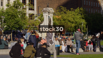People In Piccadilly Gardens In Manchester. Slow Zoom Out, UK