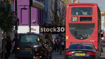 Slow Motion Shot Of Camden High Street With Traffic And People, UK