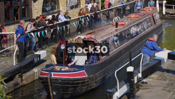 Narrow Boat Passing Through Lock In Camden, UK