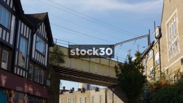 Passenger Train Passing Over Railway Bridge In Camden, UK