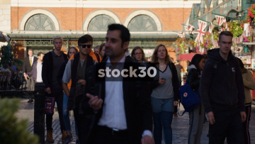 Slow Motion Shot Of People Walking By In Covent Garden, London, UK