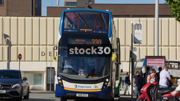 Buses Pulling Away From Bus Stop Near Debenhams In Stockport, UK