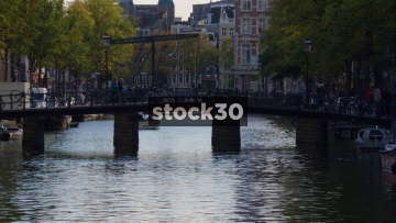 A View Down The Kloveniersburgwal Canal In Amsterdam, Netherlands