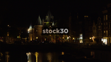 Night Time Shot Of The Waag By The Kloveniers Burgwal Canal In Amsterdam, Netherlands