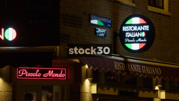 Night Time Shot Of Piccolo Mondo Ristorante Italiano On Binnen Bantammerstraat In Amsterdam, Netherlands