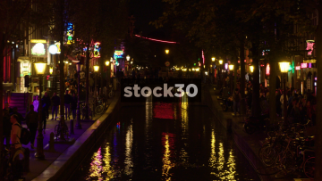Night Time Shot Of The Red Light District And Canal In Amsterdam, Netherlands
