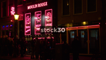 Two Views Of The Moulin Rouge Sex Theatre In Amsterdam's Red Light District, Netherlands