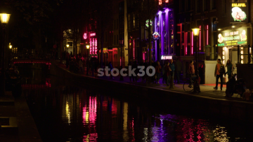 The Canal And Bars In Amsterdam's Red Light DIstrict, Netherlands