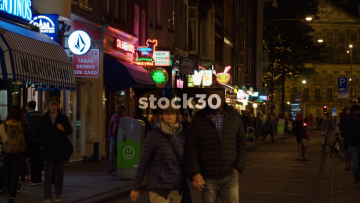 Damstraat Centrum In Amsterdam With Passing People, Netherlands